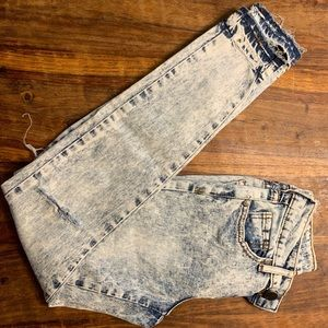 Denim - Woman's distressed skinny jeans.